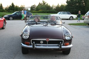 Katelyn Denbow and Marty going for a spin in a classic MG!