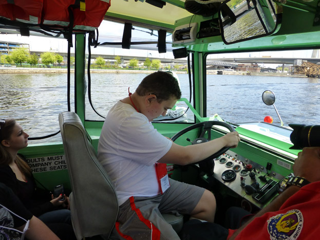 Adam steering the duck boat