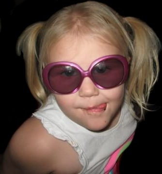 A beautiful photo of blond Bryce, sun glasses, and hair in pig-tails.